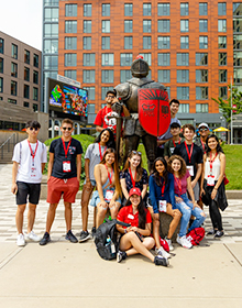 Group of students with knight statue